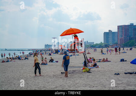 Life guard on Coney Island beach in Brooklyn, New York in the early afternoon. - Stock Photo