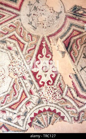 Ancient byzantine natural stone tile mosaics with floral ornament, Madaba, Jordan, Middle East - Stock Photo