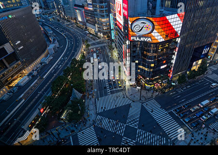 TOKYO, JAPAN, May 13, 2019 : Ginza crossing by night. The Greater Tokyo Area ranked as the most populous metropolitan area in the world.