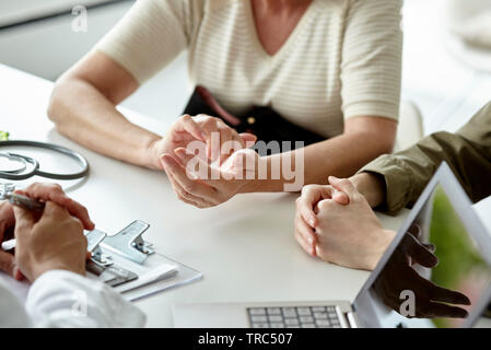 Patient talking with doctor - Stock Photo
