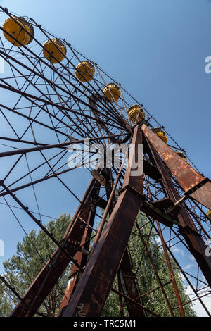 Ferris wheel in the abandoned  city of Pripyat near the former Chernobyl nuclear power plant, Chernobyl Exclusion Zone, Ukraine - Stock Photo