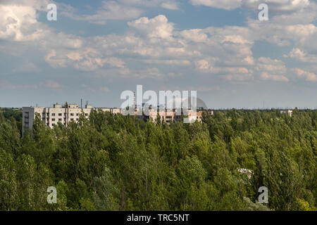 View from roof top of the abandoned city of Pripya and the Chernobyl nuclear power plant, Chernobyl Exclusion Zone, Ukraine - Stock Photo