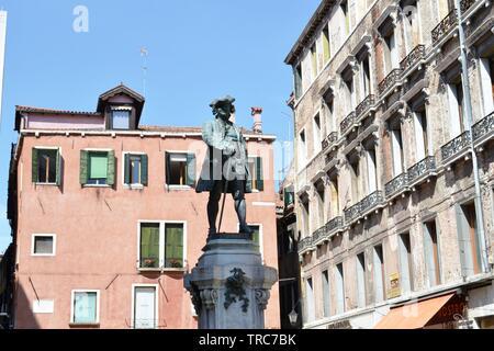 Bronze statue of the monument to Carlo Goldoni in campo San Bortolomeo of Venice city, Italy. - Stock Photo