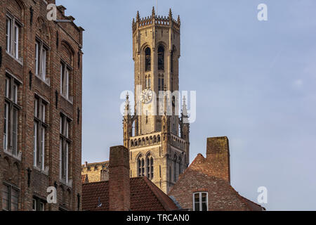Belfry of Bruges, the medieval bell tower against blue sky. The 83 meter high belfry or hallstower (halletoren) is Bruges' most well-known landmark