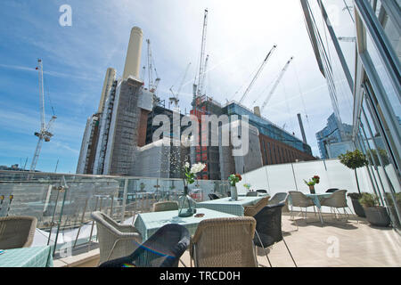 Battersea Power Station construction seen from residents area of Circus West Village in south London. 31.05.19. - Stock Photo