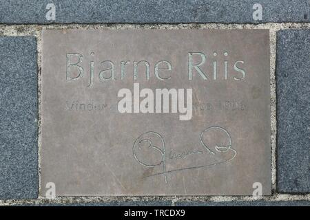 Herning, Denmark - April 9, 2016: Commemorative plaque in city of Herning, Denmark and tribute to Bjarne Riis cyclist, winner of the Tour de France - Stock Photo