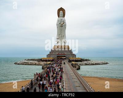 NANSHAN CULTURAL PARK, HAINAN, CHINA - Tourists and devotees at the statue of the Goddess of Mercy, Guanyin / Guan Yin / Kuan Yin / Kwan Yin. The stat