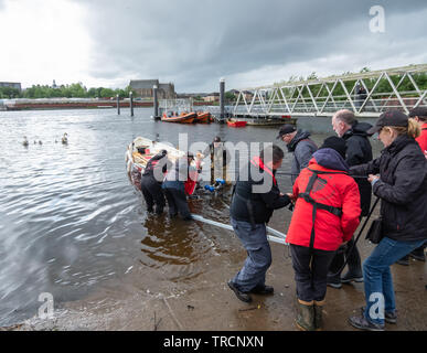Glasgow, Scotland, UK. 3rd June, 2019. The Kelvin Kelpie is launched on The River Clyde at Kelvin Harbour. The new boat is a St Ayles skiff and was hand built by Glasgow Coastal Rowing Club at a workshop in the Riverside Museum. Credit: Skully/Alamy Live News - Stock Photo