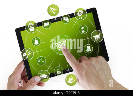 gardening equipment e-commerce concept, online shopping on digital tablet, hand pointing and touch screen with garden tools icons, isolated on white b - Stock Photo