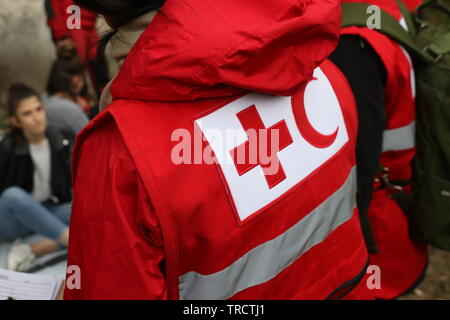 Details with the Red Cross and Red Crescent symbol on a uniform. Red Cross and the Red Crescent, are international humanitarian organizations - Stock Photo