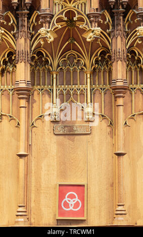 Sign above a wooden carved and decorated bench seat in the choir of York minster cathedral, reserved for the bishop of Hull. - Stock Photo