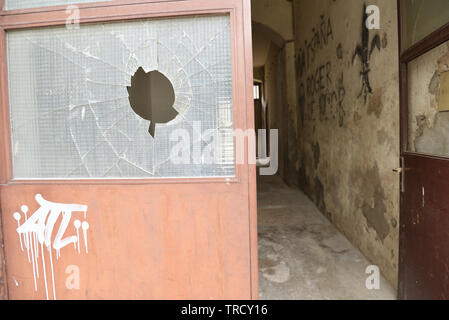 Scars of war in Bosnia still visible on walls of Mostar - Stock Photo