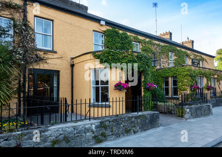 Dunraven Arms Hotel in Adare, Ireland - Considered One of Ireland's Prettiest Towns - Stock Photo