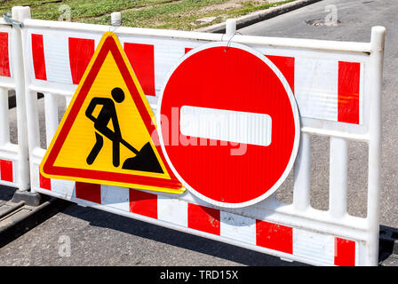 Road works traffic sign at the city street, stop sign! Road under construction - Stock Photo