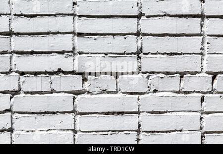 White brick wall as background texture. Bricks masonry with seams - Stock Photo