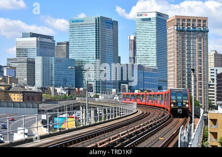 East London urban landscape inTower Hamlets with building development at Canary Wharf banking business offices & public passenger transport railway UK - Stock Photo