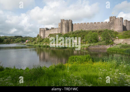 Pembroke Castle in early evening light, Pembrokeshire, Wales - Stock Photo