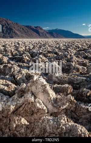Salt pinnacles on The Devil's Golf Course, Death Valley National Park, California USA - Stock Photo