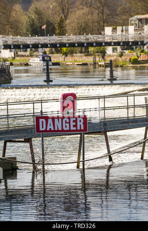 MARLOW, ENGLAND - MARCH 2019: Large red danger sign on the River Thames in front of the weir at Marlow - Stock Photo