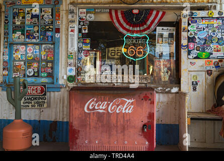 WINDOW AND ANTIQUE COCA COOLER ON ROUTE 66 AT THE HACKBERRY GENERAL STORE - Stock Photo