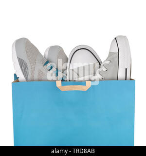 Shopping bag with sport shoes isolated on white background - Stock Photo