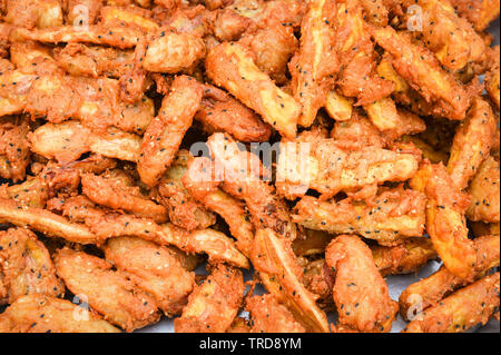 Fried banana with sesame on tray in the street food thailand asian - Stock Photo