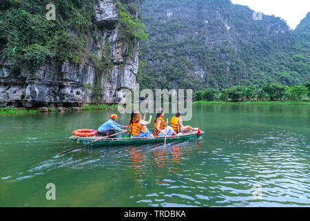 Tourists leaving marina travel to visit Ecotourism the natural landscape in small boat along the river - Stock Photo