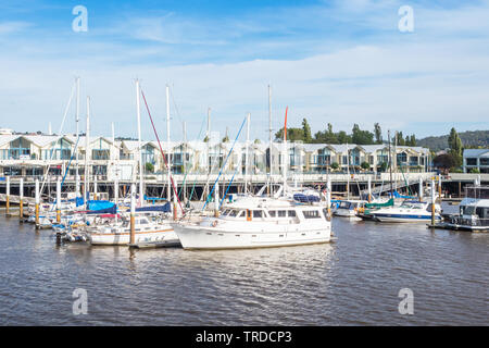 TASMANIA, AUSTRALIA - FEBRUARY 15, 2019: Pleasure craft moored in the North Esk River at Launceston Seaport in Tasmania, Australia. - Stock Photo
