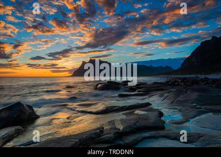 rocks on Uttakleiv beach in evening light, Norway, Lofoten Islands, Utakleiv - Stock Photo