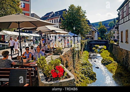 tourists in the old city with river Erft, Germany, North Rhine-Westphalia, Eifel, Bad Muenstereifel