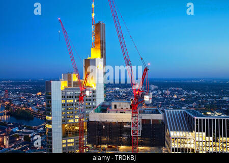 construction site in the financial district next to Commerzbank tower block and Taunus Tower in evening light, Germany, Hesse, Frankfurt am Main - Stock Photo