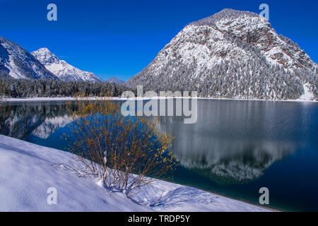 lake Plansee in winter, Austria, Tyrol - Stock Photo