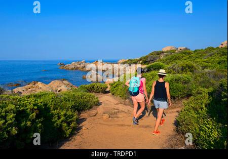 two women on a footpath along the coast between Sartene and Bonifacio, France, Corsica, Bruzzi - Stock Photo