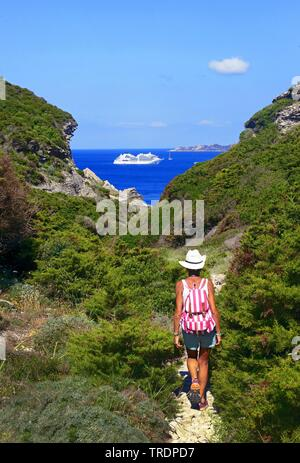 footpath at the rocky coast, cruise liner in background, France, Corsica, Bonifacio - Stock Photo