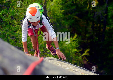 female climber on a rock wall in the Chamonix Valley, France, Savoie, Chamonix - Stock Photo