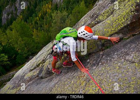 climber on a rock wall in the Chamonix Valley, France, Savoie, Chamonix - Stock Photo