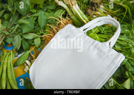 Eco cotton fabric bag on fresh vegetables in the market free plastic shopping / Zero waste use less plastic - Stock Photo