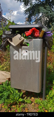 overfilled trash can, Germany - Stock Photo