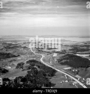 highway A8 with lake Chiemsee in the background, aerial picture from the year 1960, Germany - Stock Photo