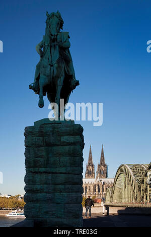 equestrian statues of Kaiser Wilhelm I with Cologne Cathedral and Hohenzollern Bridge, Germany, North Rhine-Westphalia, Rhineland, Cologne - Stock Photo