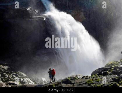 Two montain hiker in front of the Krimml Waterfalls in Salzburg state, Austria, Salzburger Land, Krimml