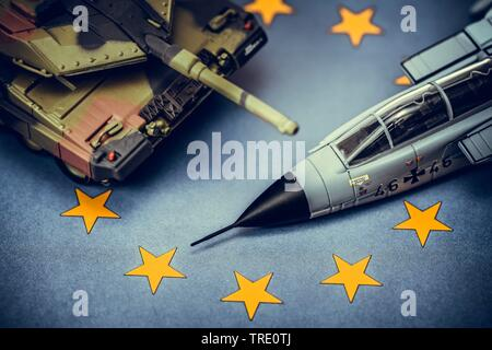 EU corporate defence projects symbolized by images of weapon systems on an European flag - Stock Photo