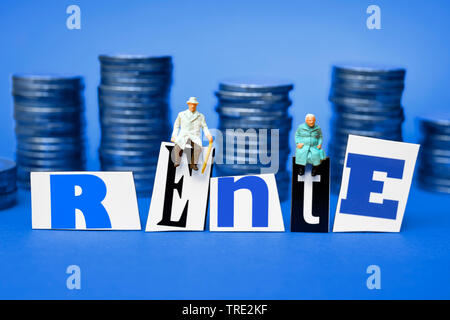 figures with stacks of Euro coins and the word Rente, retirement provision, Germany - Stock Photo