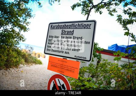 spa tax signs on the Baltic Sea beach, Germany, Schleswig-Holstein, Timmendorfer Strand - Stock Photo