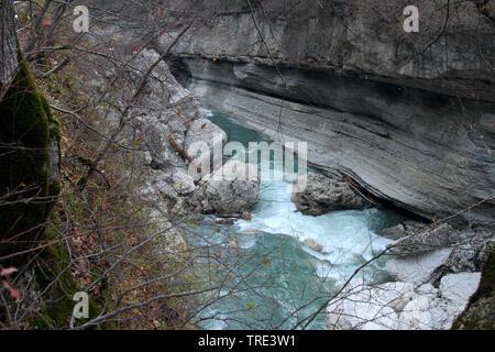 Turbulent stream flows among the cliffs in the Khadzhokhskaya gorge. - Stock Photo