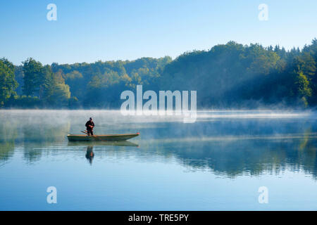 angler on lake Burgaeschisee, Switzerland, Solothurn - Stock Photo