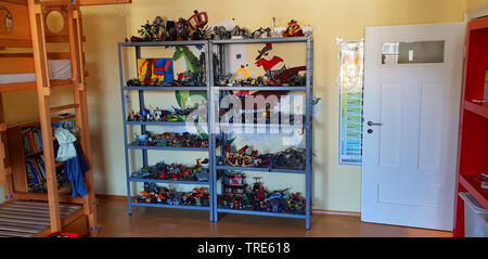 children's room with rack full of Lego playthings, Germany - Stock Photo