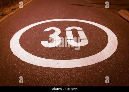 mark on asphalt, speed limit of 30 km/h, Germany - Stock Photo