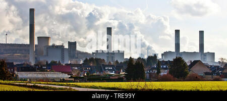 residential district in front of brown coal power station Frimmersdorf, Germany, North Rhine-Westphalia, Bergheim, Grevenbroich - Stock Photo