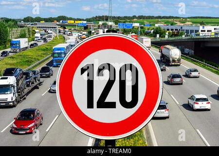 Traffic sign with speed limit 120 against a German Autobahn as background image - Generel speed limit - Stock Photo